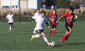 Prep Soccer's Matias Correa, a post-grad, gets ahead of Rivers School during the playoffs. Photo courtesy of South Kent School.